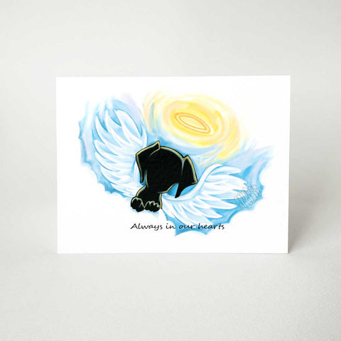 "A greeting card with a black dog angel on the front, that reads, ""Always in our hearts"""