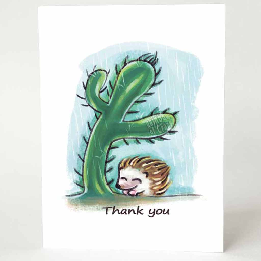 "a greeting card with a hedgehog under a cactus, getting protection from the rain. the card reads, ""thank you"""