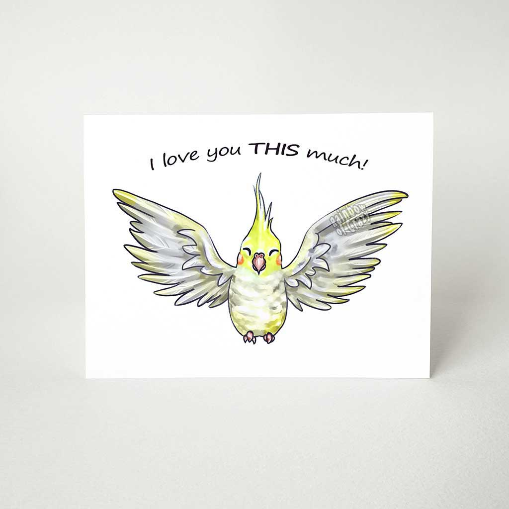 "A greeting card with art of a yellow cockatiel pet bird with its wings stretched out. The card reads, ""I love you THIS much!"""