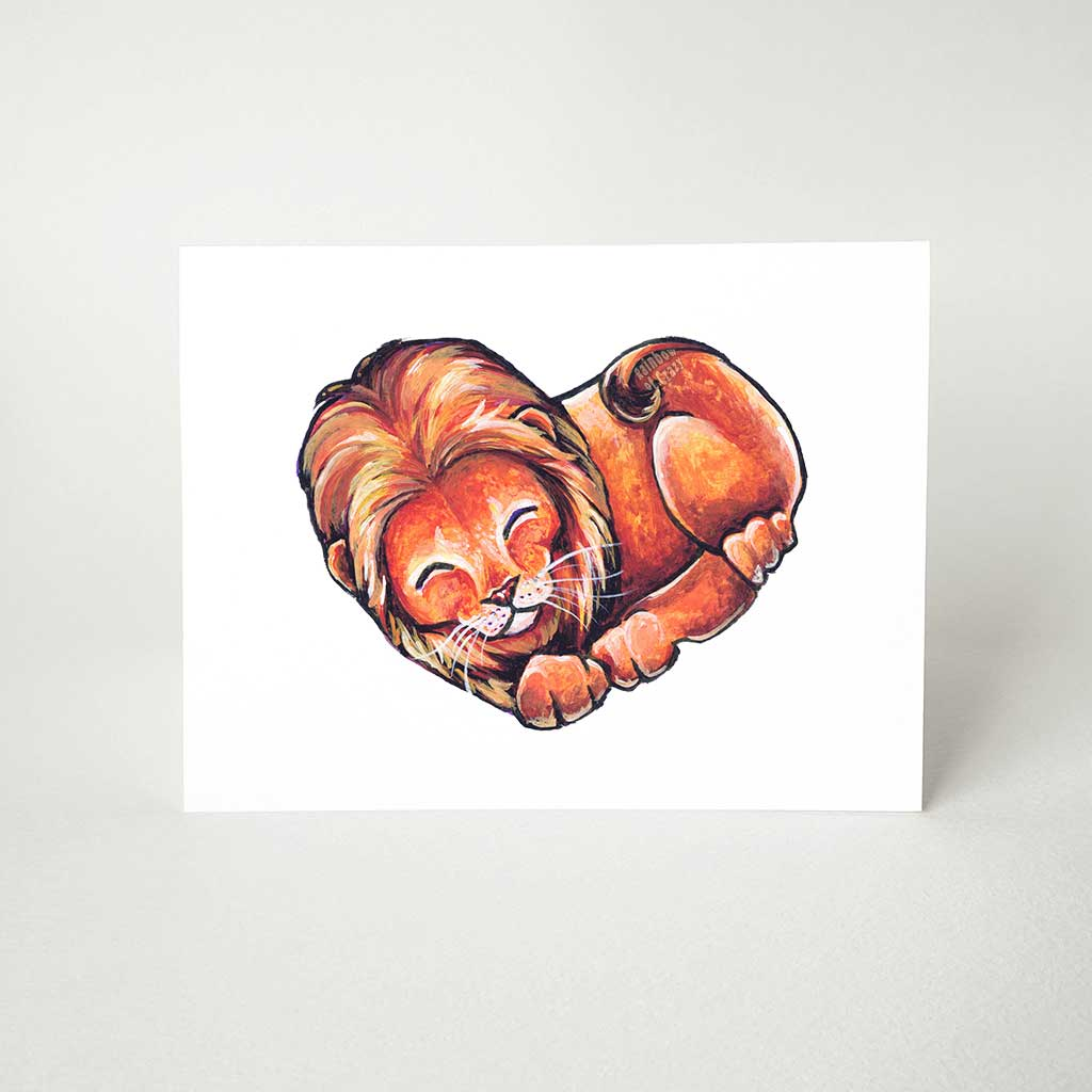 A greeting card, printed with an illustration of a lion, forming the shape of a heart.