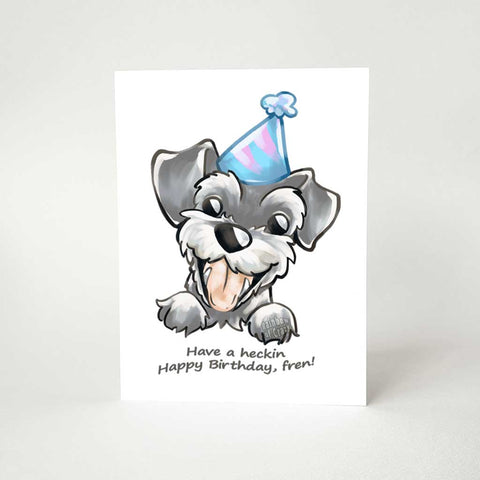 "a greeting card, printed with an illustration of a smiling miniature schnauzer with a blue birthday hat. the card reads, ""have a heckin happy birthday, fren!"""