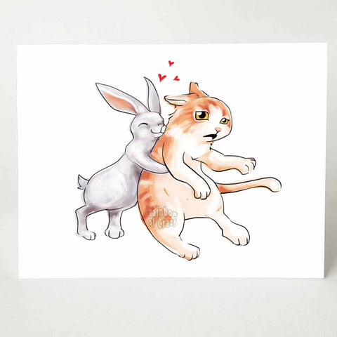 a greeting card with an illustration of a white rabbit giving a giant hug to a surprised orange cat