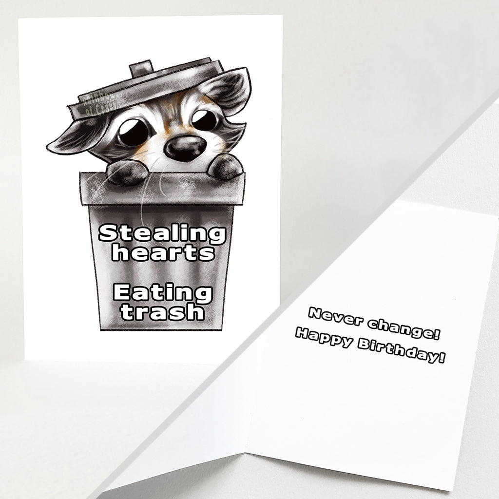 "a greeting card with art of a baby raccoon peeking out from a garbage can. the card reads, ""stealing hearts. eating trash"" on the front and ""never change! happy birthday!"" on the inside"