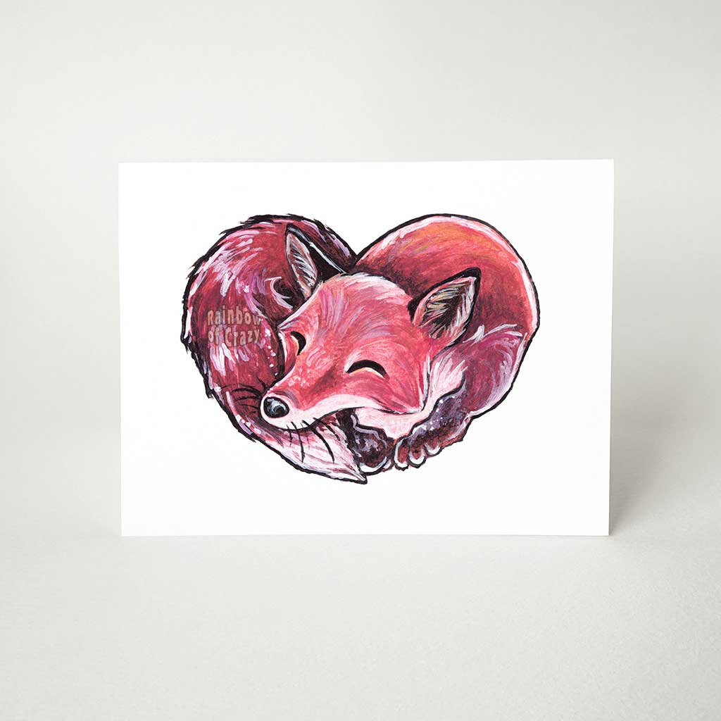 a greeting card with art of a sleeping red fox, forming the shape of a heart