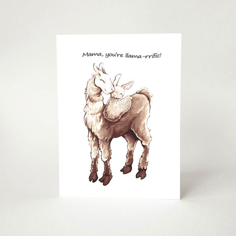 "A greeting card with an illustration of a white and brown llama, with a baby llama curled up on its back. The card reads, ""Mama, you're llama-rrific!"""