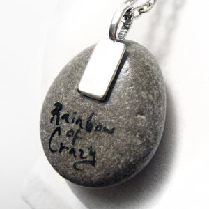 "the back of the chihuahua stone, signed wtih ""Rainbow of Crazy"""