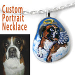a personalized pet portrait of a boxer dog as an angel, painted on a small beach rock and made into a pendant necklace