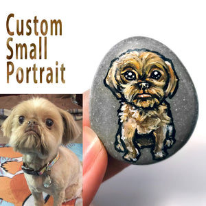 a beach rock painted with custom art of a brown Shih Tzu dog