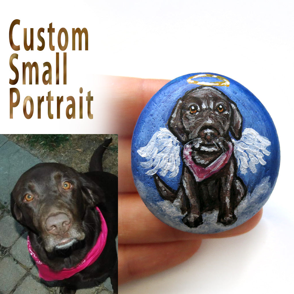 a beach stone personalized with a pet portrait painting of a brown labrador retriever dog as an angel