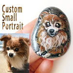 a small beach rock with a custom portrait of a brown and white long haired chihuahua dog