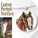 A custom pet portrait painting, on a circle wood necklace, of a brown and white horse.