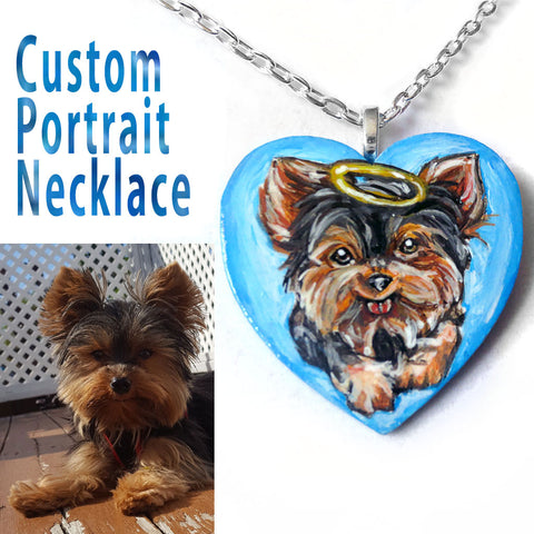 A custom portrait necklace, of a yorkshire terrier painted as an angel, on a heart shaped wood pendant.