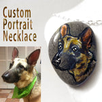a german shepherd dog, custom painted on a beach rock, and handmade into a necklace