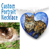 a wood heart custom painted blue with a brown and orange cat, handmade into a necklace