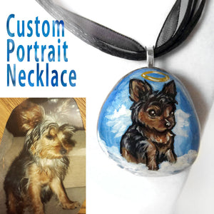 a personalized angel pet portrait necklace, with yorkshire terrier art, hand painted on a beach stone