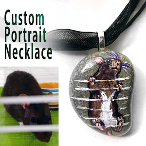 a custom painted pendant necklace, handmade from a beach stone, with a portrait of a broken and white rat climbing the bars of its cage