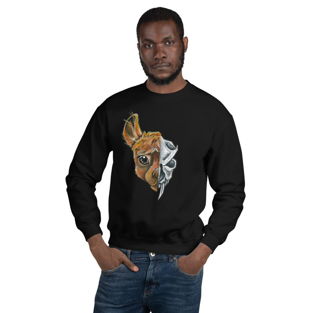 A man is wearing a unisex sweatshirt in the colour black, printed with an image split into two: the left side features the face of a brown alpaca, and the right side features an evil looking alpaca skull.