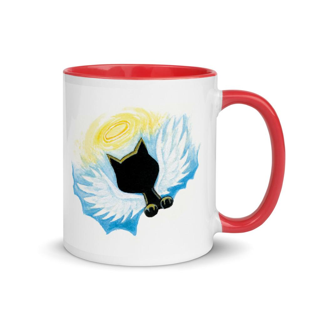 An 11 oz white ceramic coffee mug, with red trim and handle, printed with a artwork of a black cat with angel wings and halo, sittting on clouds