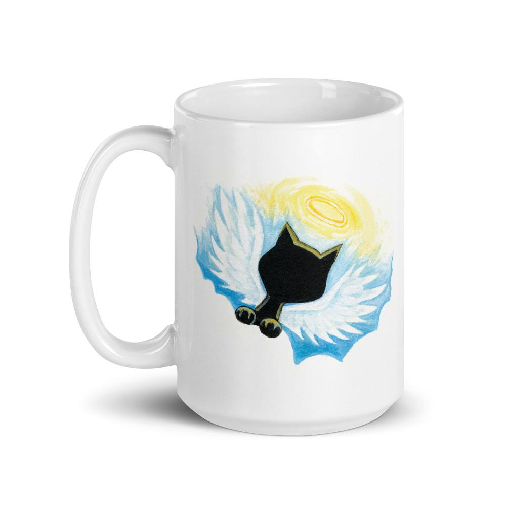 A white ceramic 15 oz mug with art of a black cat angel on the front