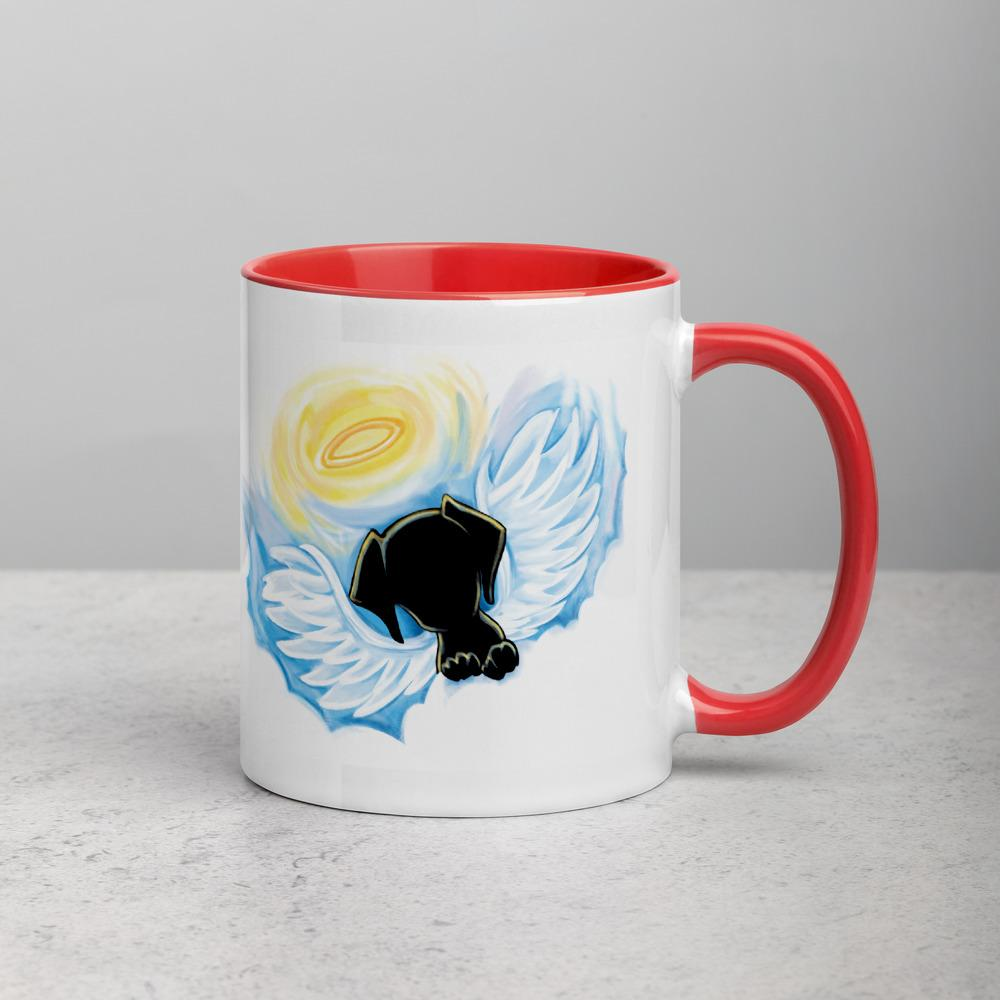An 11 oz ceramic coffee mug, with red trim, is printed with a painting of a black dog as an angel with wings and halo, peeking out from the clouds