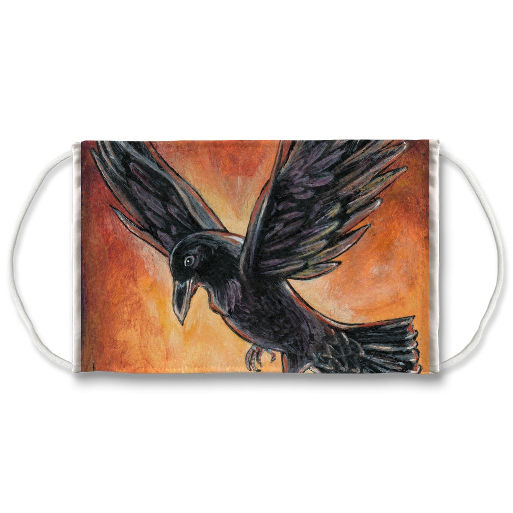 A reusable face mask featuring a raven bird flying in front of a red and orange sky. Art is from the Death card from the Animism Tarot