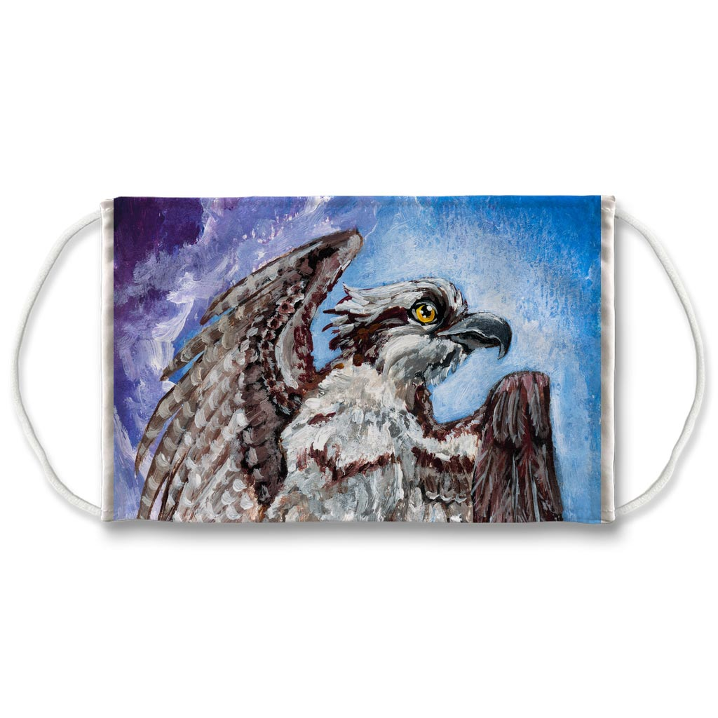 A reusable face mask features artwork of an osprey bird about to take fight, in front of a blue and purple sky. Artwork is from the Queen of Swords card from the Animism Tarot