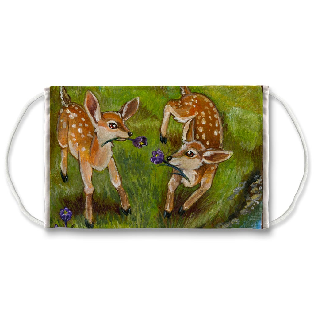A reusable face mask, printed with art of two baby deer playing with flowers. Art from the Animism Tarot.