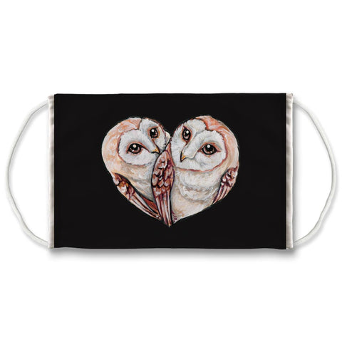 A black reuseabe face mask is printed with an illustration of two barn owls curled up together, forming the shape of a heart