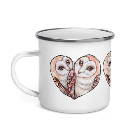 An white enamel mug, printed with two barn owls close together forming the shape of a heart.