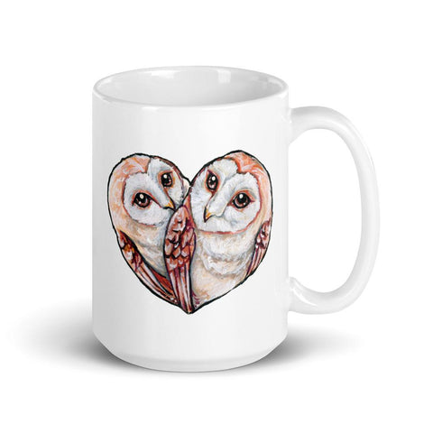 A white ceramic 15 oz mug, printed with two barn owls close together forming the shape of a heart.