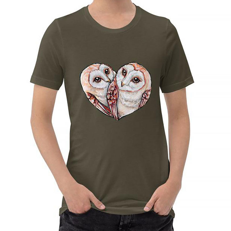 A man wearing the Barn Owl Love Premium Unisex T-Shirt in army brown, includes art of two barn owls forming the shape of a heart.