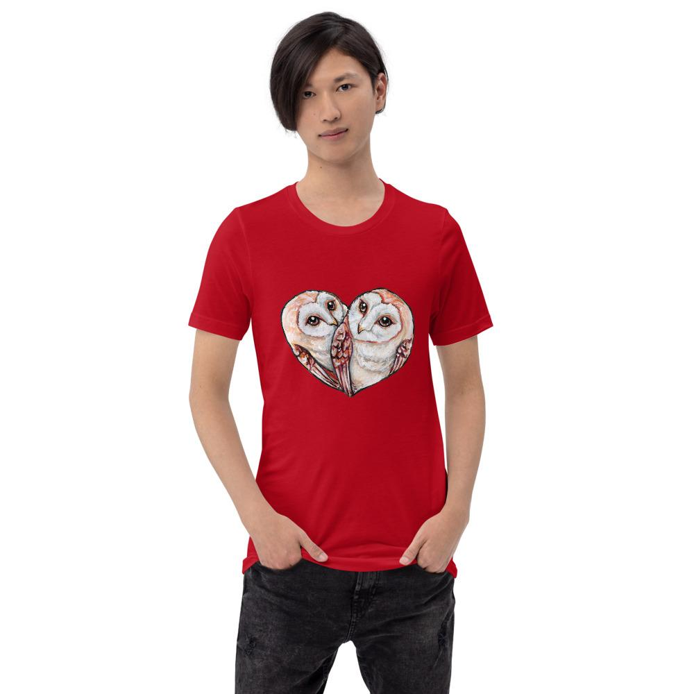 A man wearing the Barn Owl Love Premium Unisex T-Shirt in red, includes art of two barn owls forming the shape of a heart.