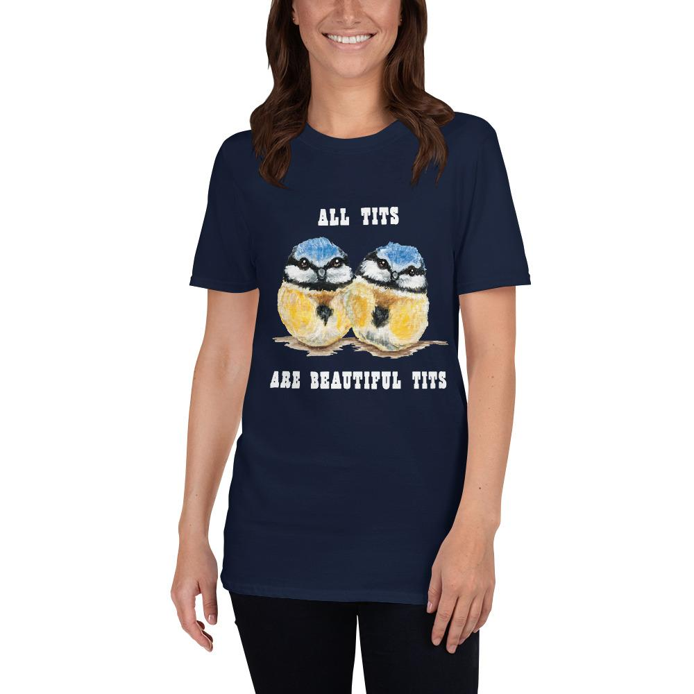 "A woman wearing the Beautiful Tits Basic Unisex T-shirt in navy blue, with art of two blue tit birds, and the words, ""all tits are beautiful tits"""