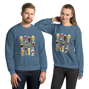 A man and woman wearing the Beer Lovers Unisex Sweatshirt in the colour indigo blue, featuring art of 10 styles of beer in 10 different glasses