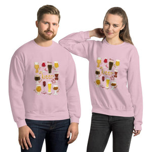A man and woman wearing the Beer Lovers Unisex Sweatshirt in the colour light pink, featuring a graphic of 10 styles of beer in 10 different glasses