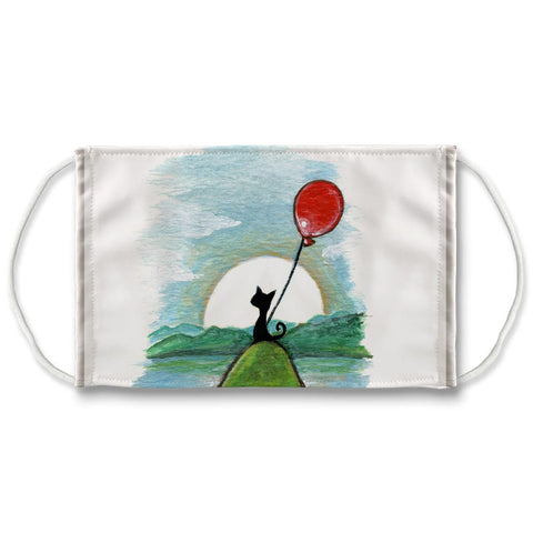 A reusable white face mask, printed with art of a black cat holding a red balloon, sitting om top of a hill, with the sun behind.