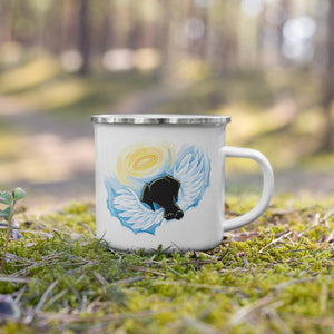 A white enamel mug with silver rim, is printed with a graphic of a black dog as an angel, with wings and halo, peeking out over the clouds.