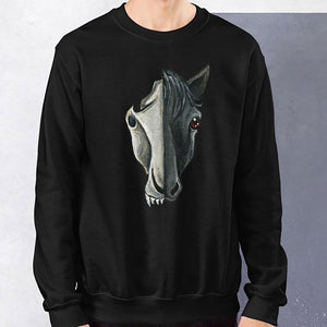 A man is wearing a unisex sweatshirt in the colour black, which is printed with a split graphic: the right side features the face of a black horse, and the left side features an evil looking horse skull