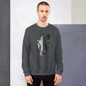 A man is wearing a unisex sweatshirt in the colour dark heather grey, which is printed with a split illustration: the right side features the face of a black horse, and the left side features an evil looking horse skull