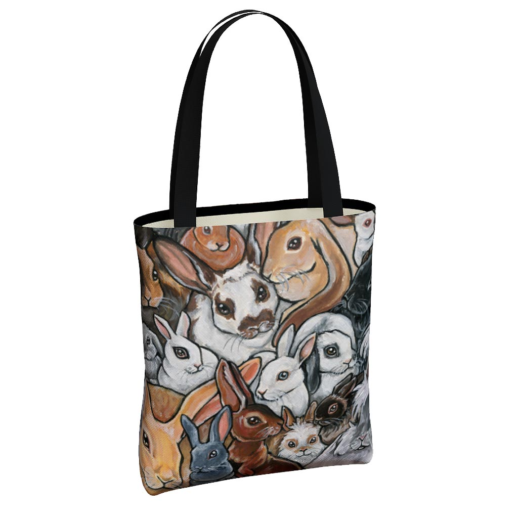 A canvas tote bag, printed with an illustration of many rabbit breeds!