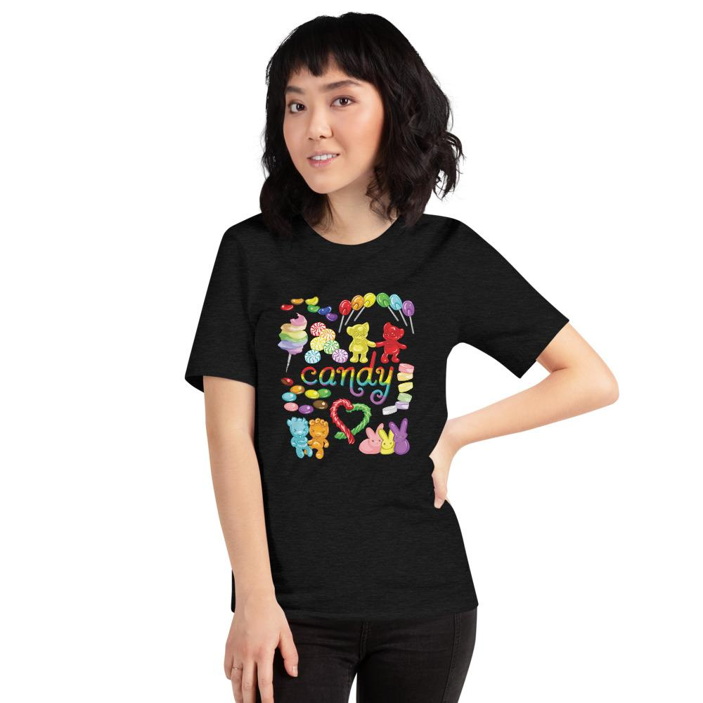 A woman wearing the Candy Lovers Premium Unisex T-shirt in black heather, which includes an illustration of 10 types of rainbow candy