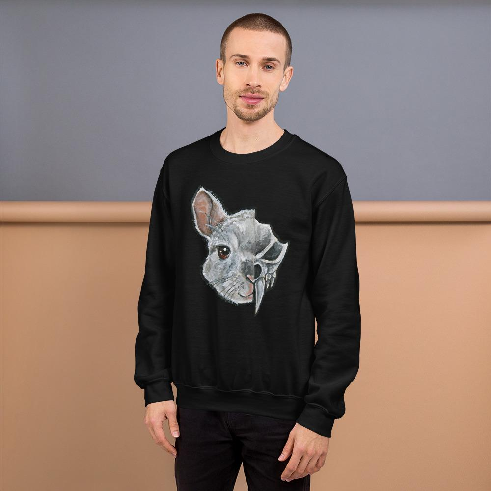 A man wears a unisex sweatshirt in the colour black, which is printed with art of a split image: the left side features a chinchilla's face and the right side features an evil looking chinchilla skull