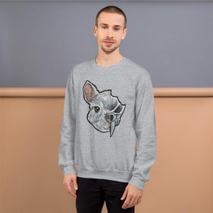 A man wears a unisex sweatshirt in the colour sport grey, which is printed with art of a split image: the left side features a chinchilla's face and the right side features an evil looking chinchilla skull