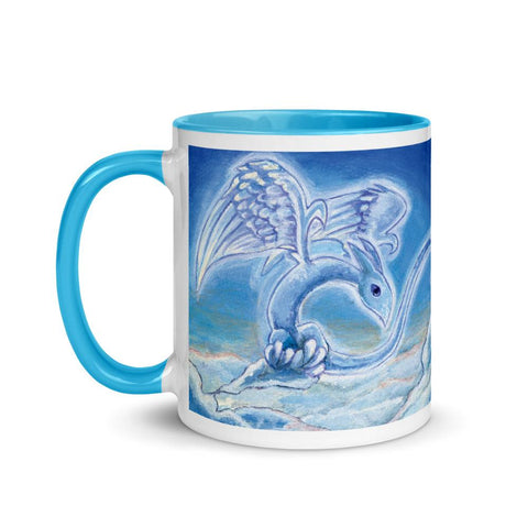 A 11 oz white ceramic coffee mug, with trim in the colour blue, printed with art of a cloud dragon flying over the clouds