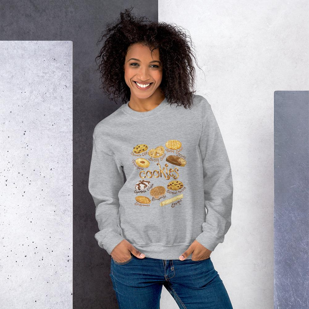 A woman wearing the Cookie Lovers Unisex Sweatshirt in the colour sport grey, which features an image of 10 types of cookies