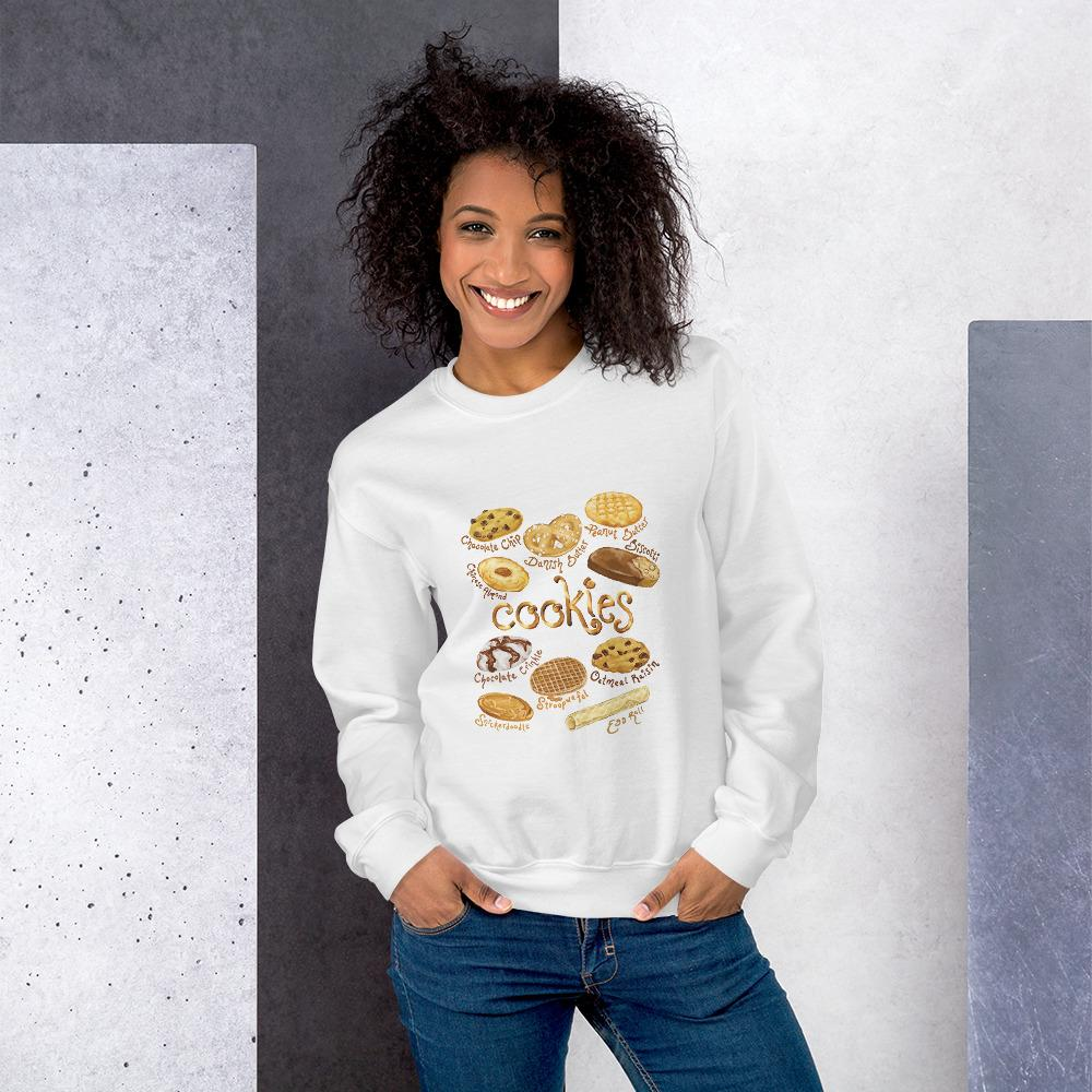 A woman wearing the Cookie Lovers Unisex Sweatshirt in the colour sport white, which features a graphic of 10 types of cookies