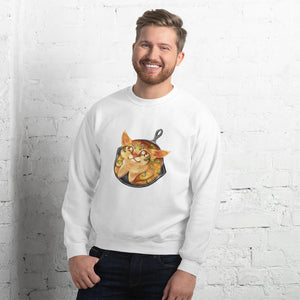 A man is wearing a unisex sweatshirt in the colour white, featuring an illustration of a cornbread cat with jalapenos, sitting in a cast iron pan.