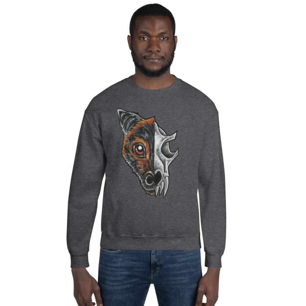 A man is wearing a unisex sweatshirt in the colour dark heather grey, which is printed with a split graphic: the left side features the face of a flying fox bat, and the right side features an evil looking bat skull