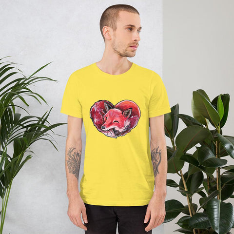 A man is wearing the Fox Love Premium Unisex T-shirt in the colour red, which includes a print of a red fox sleeping in the shape of a heart.