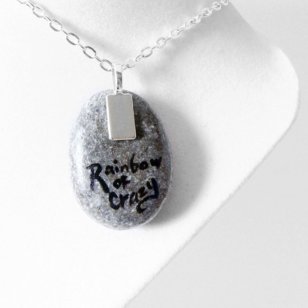 "the back of the tree swing stone necklace, signed with ""Rainbow of Crazy"""